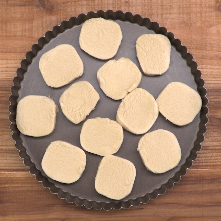 sugar cookie fruit tart dough pieces in pan