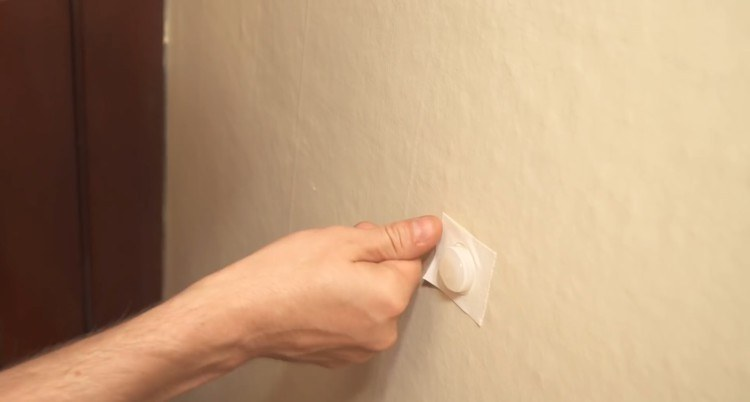 Make a stopper for your door using hot glue.