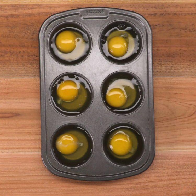 Muffin Tin Poached Eggs raw eggs in muffin tin