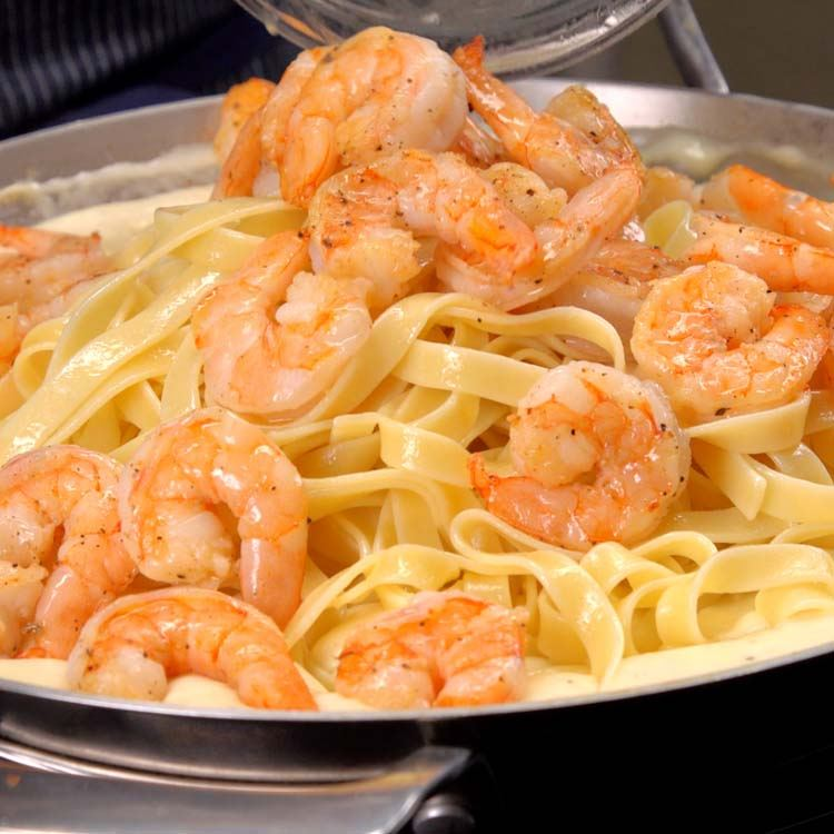 Shrimp Alfredo Pasta tossing shrimp in pan with pasta