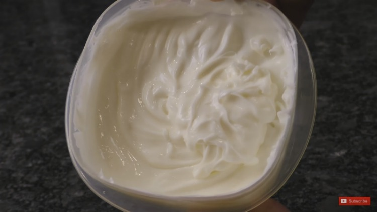 Make body cream out of lotion, petroleum jelly and essential oils