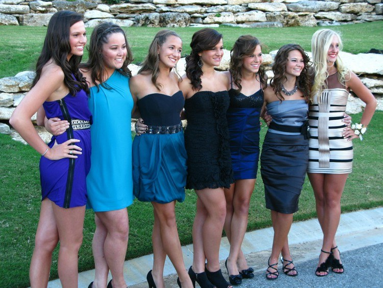 Group of girls dressed for homecoming.