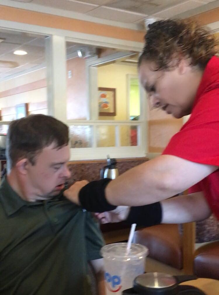 Image of dwayne getting a pin from waitress at iHop