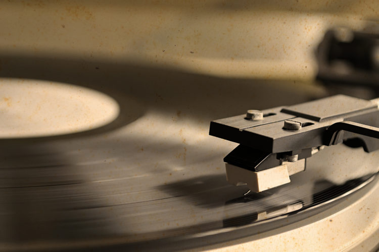 Image of record player stylus on a rotating disc