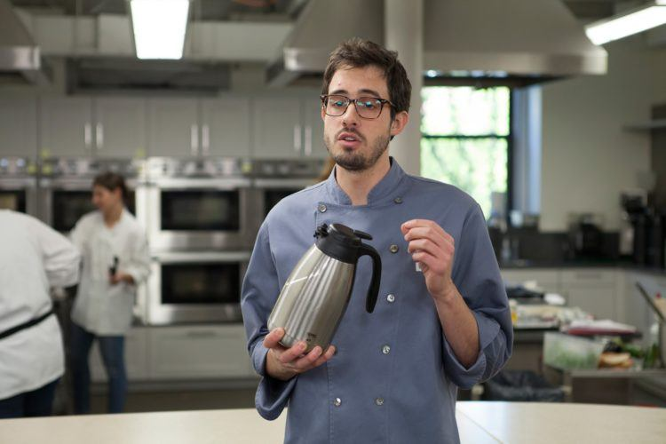 Chef with carafe.
