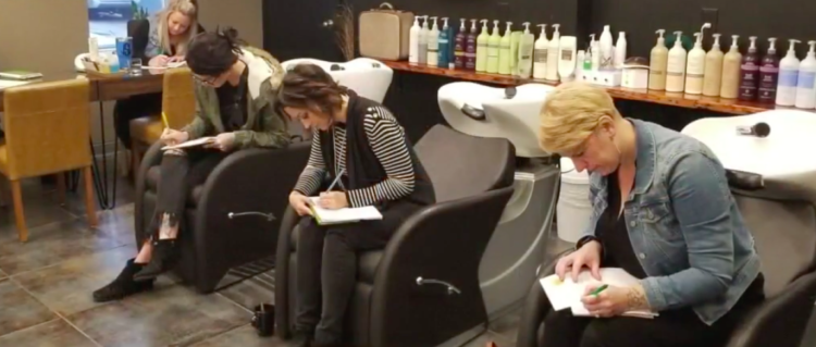 Image of hair stylists writing