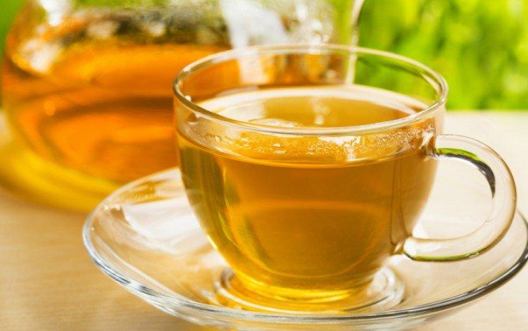 glass tea cup on wood table
