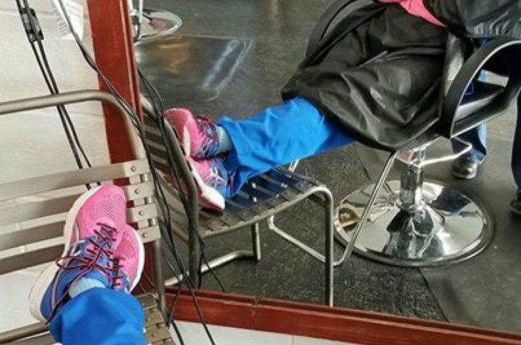 Image of nurse's sneakers at salon.