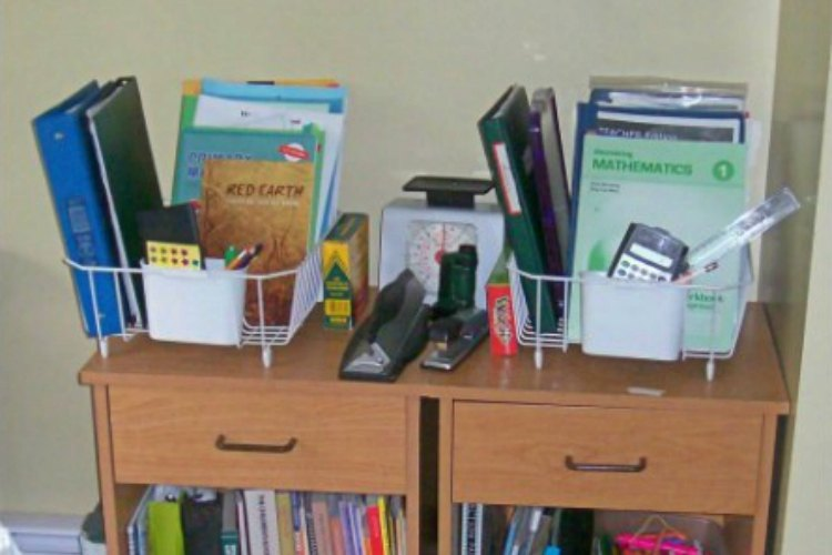 Use a dish rack to organize school books and supplies