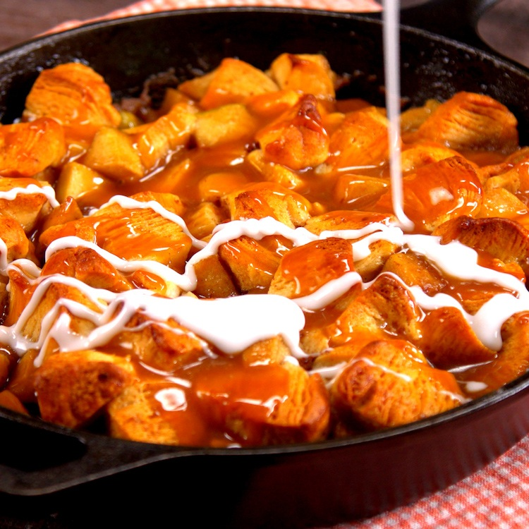 Caramelized apples and flaky bites of buttery biscuits baked in a skillet and double-drizzled with salted caramel sauce & icing.