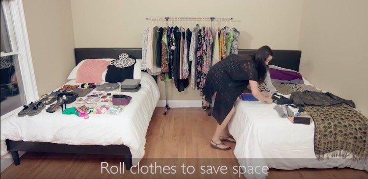 Rachel rolling clothes in bedroom