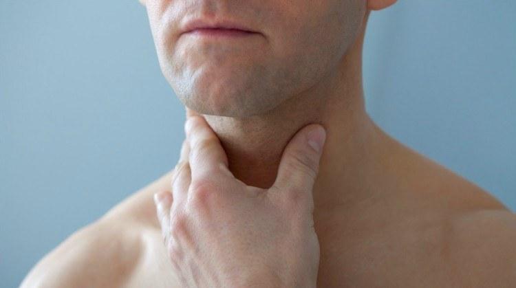 Image of men clutching neck.