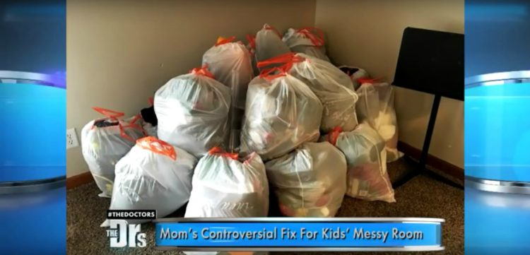 Image of Mom's punishment for daughters' messy room, which is trashbags full of belongings.