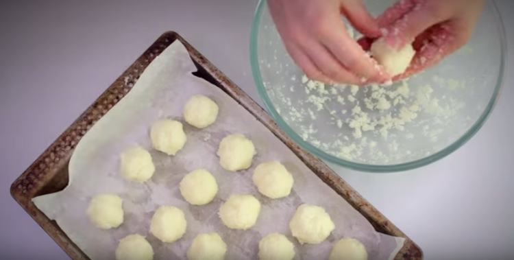 Roll mixed coconut macaroon dough into bite-sized balls