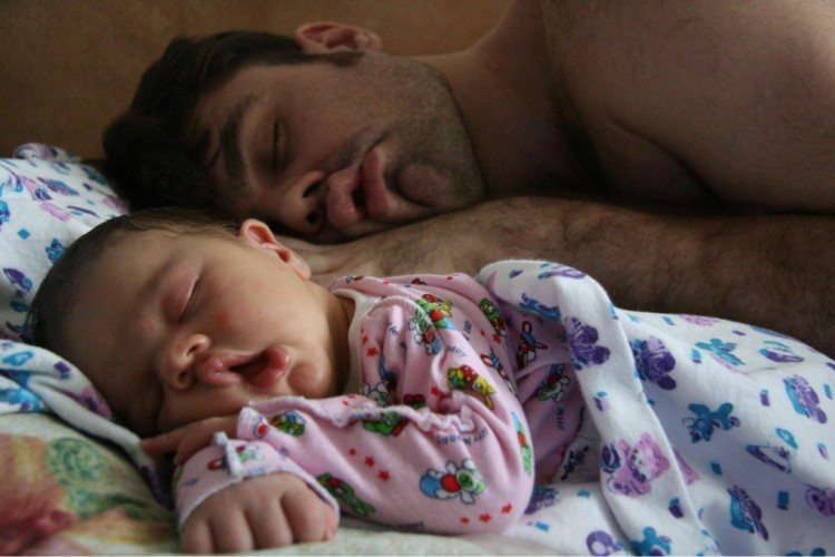 Pic of dad and baby sleeping alike.