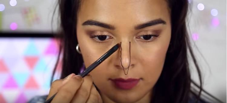 Using pin to contour nose.