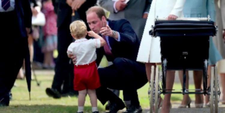 Prince William crouches near son