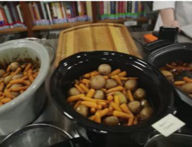 various slow cookers filled with potatoes and carrots