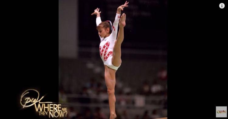 Dominique Moceanu performing gymnastics during 1996 Olympics