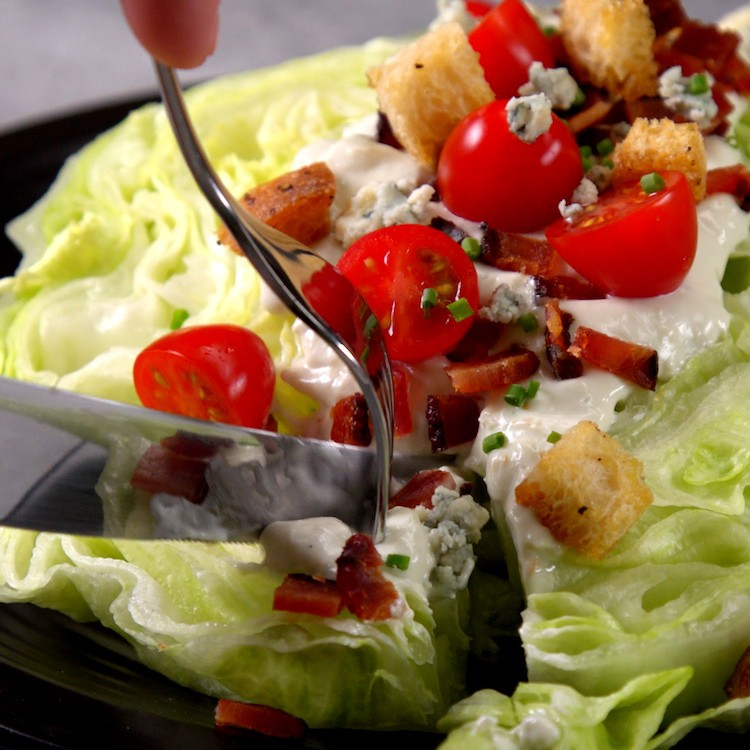 Chilled, crisp iceberg lettuce covered in creamy blue cheese dressing, bacon, croutons, & tomatoes--plus one new twist that makes this the ultimate wedge salad.
