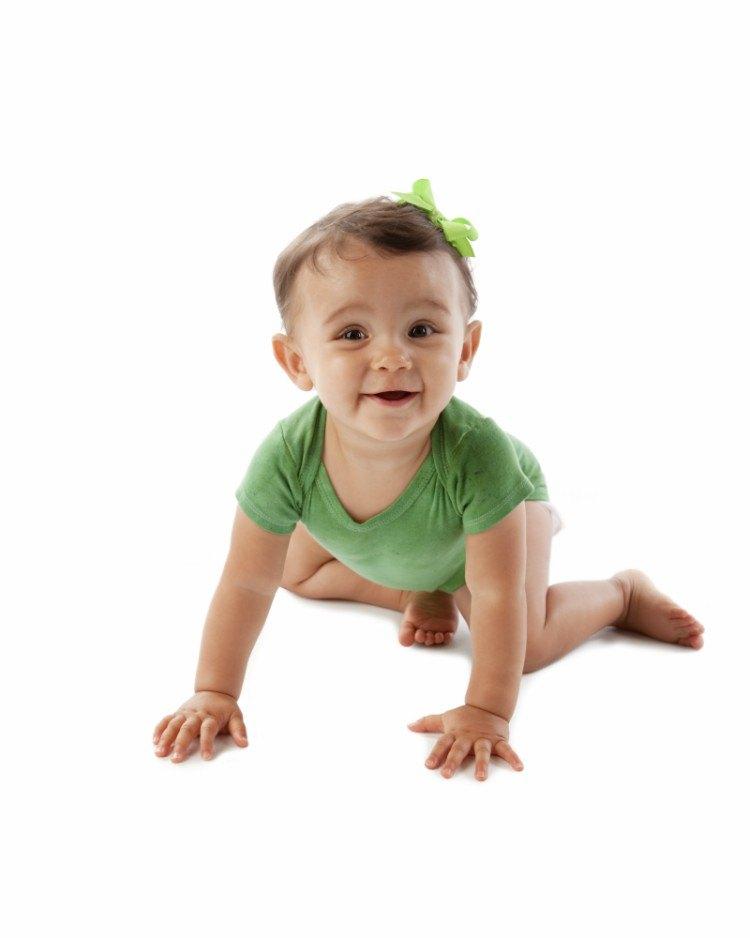 Image of baby girl crawling.