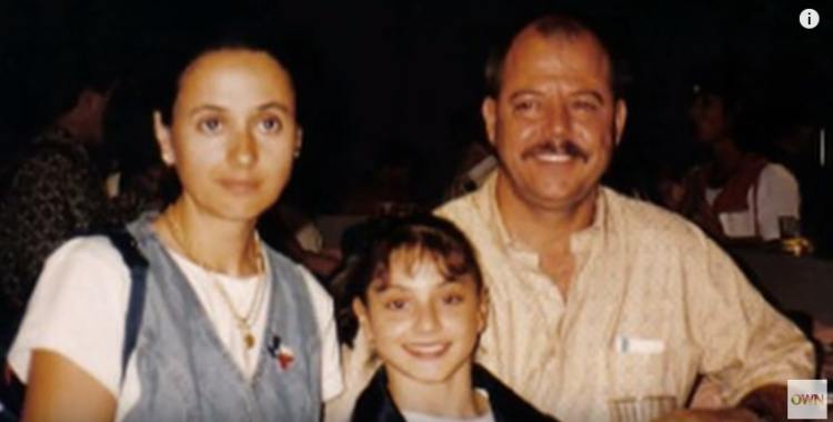 Dominique Moceanu as a child with her mother and her father