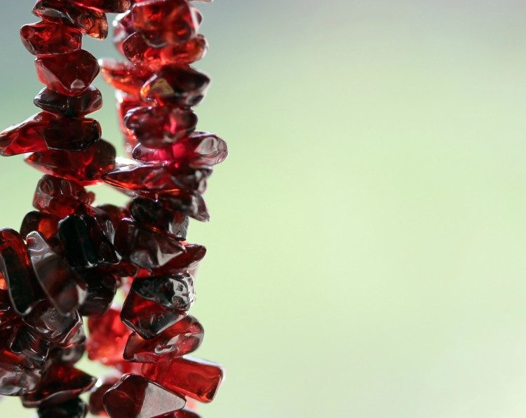 Image of garnet stones on a necklace.