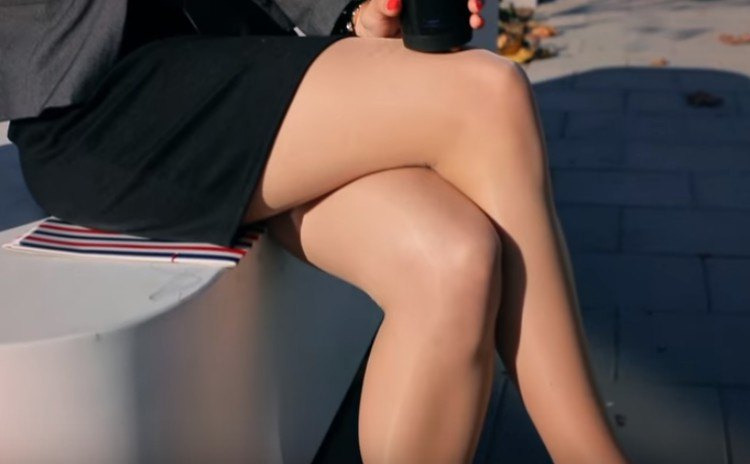 Image of woman with her legs crossed.