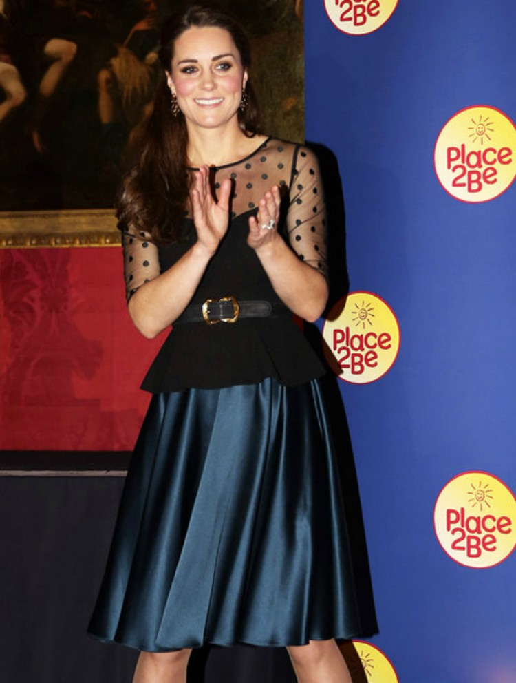 Image of Kate Middleton clapping.