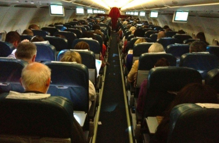cabin view of crowded airplane