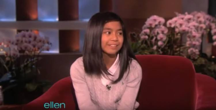 10-year-old Maria sits on Ellen's couch.