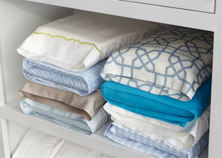 Sheets stored in pillow cases.