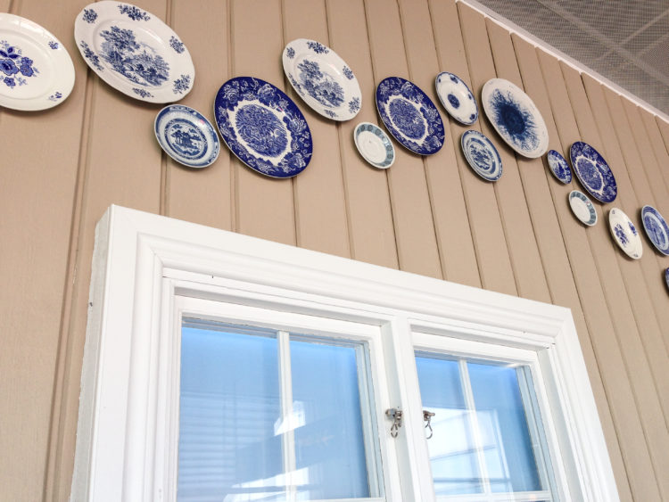 Hanging plates on wall.