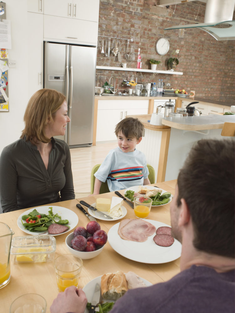 Image of family at dinner table