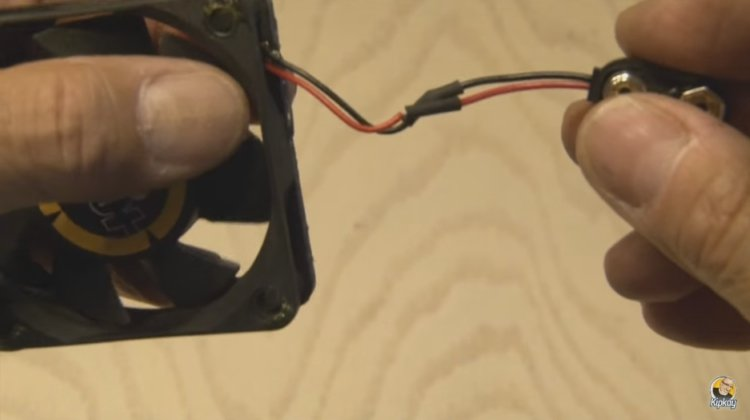 Solder a 9-volt battery clip to a computer fan