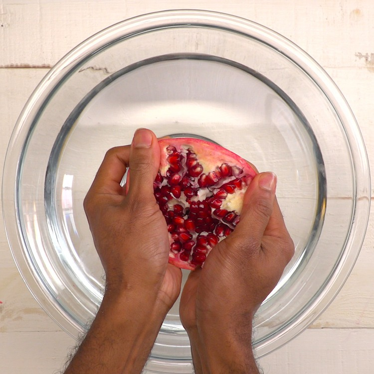 How to effortlessly cut and de-seed a pomegranate with ZERO mess, and turn those gorgeous seeds into a glass of delicious pomegranate juice--without a juicer.