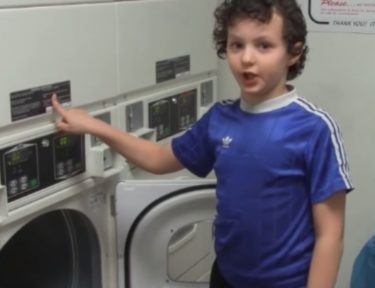 kid by dryer