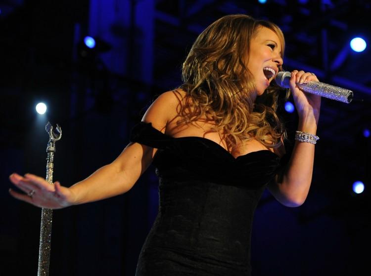 Image of Mariah Carey singing on stage