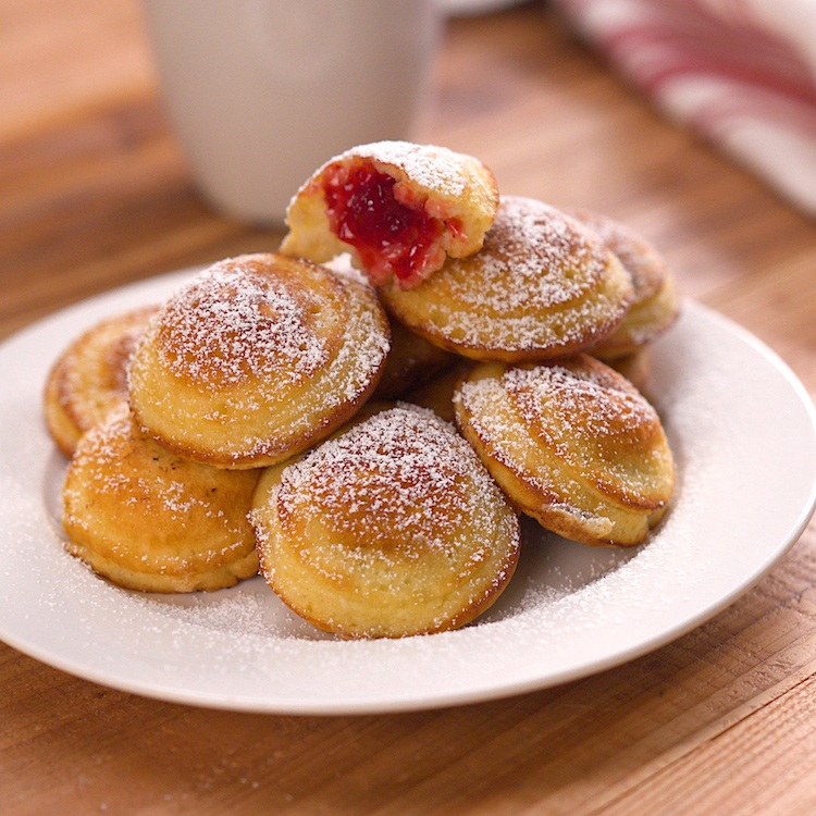 Irresistible Danish pancake bites stuffed with jam & chocolate, and dusted with powdered sugar. Don't worry, they're easier to make than they are to pronounce.