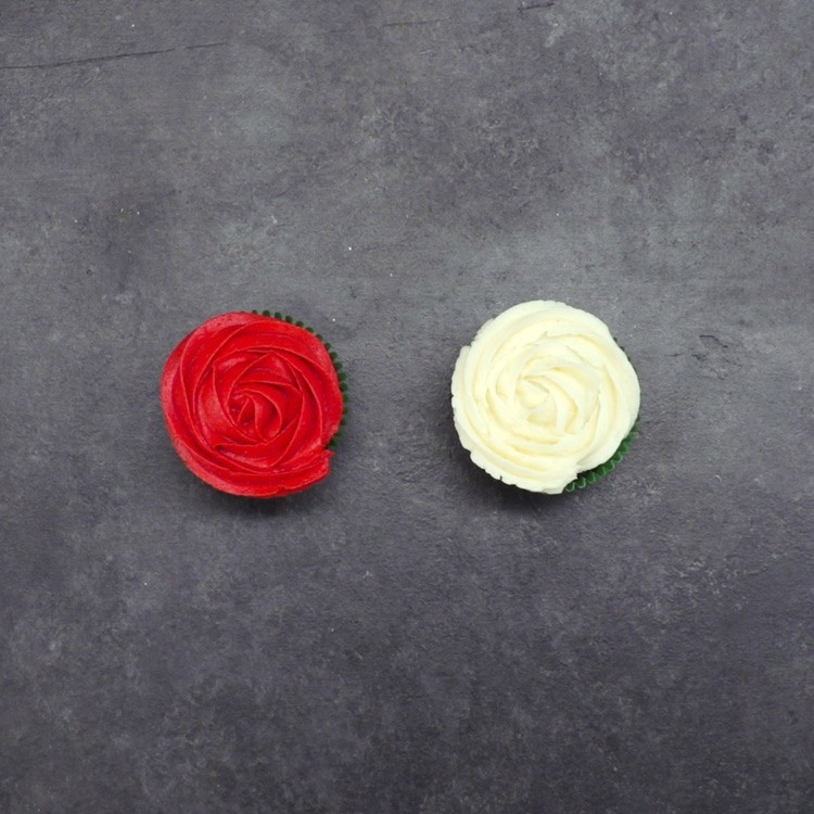 Pipe a rose spiral on each cupcake. Alternate with the colored buttercream to make a more colorful arrangement.
