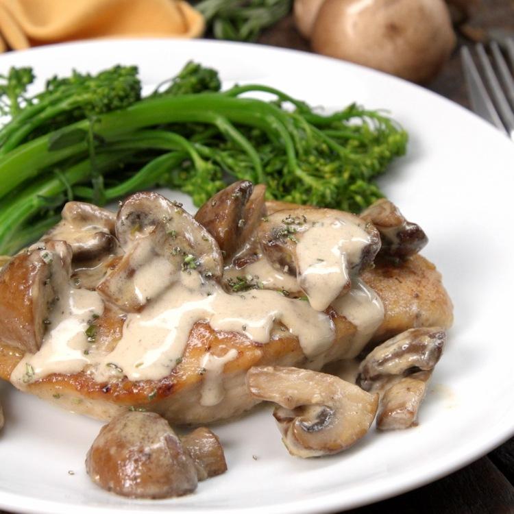 Rosemary portobello chicken on white plate