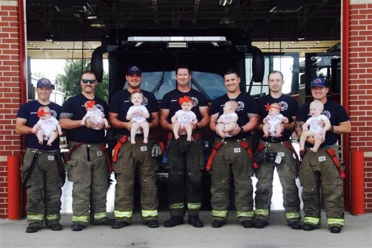 Pic of babies and dads at Glenpool fire station.