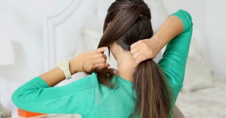 Take bottom half section of hair and make ponytail at nape of neck