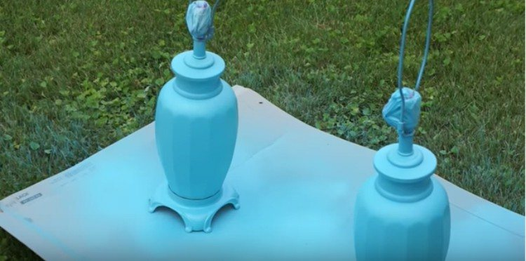 blue painted lamps on lawn