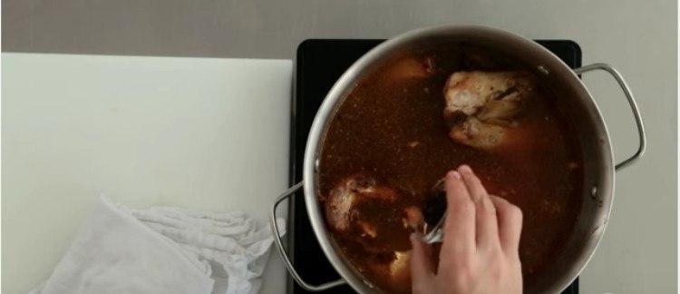 seasoning pot of chicken stock with peppercorn