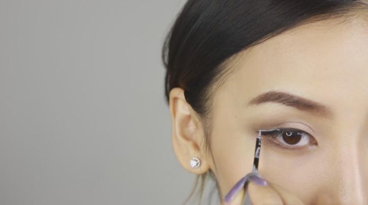 Apply glitter liner on top of end of regular liner