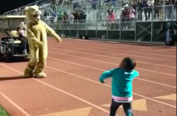 Anessah dances with mascot