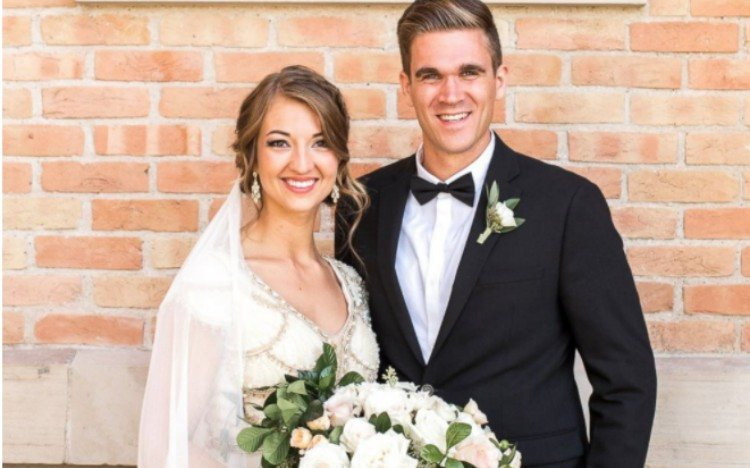Mikayla and her husband pose on their wedding day