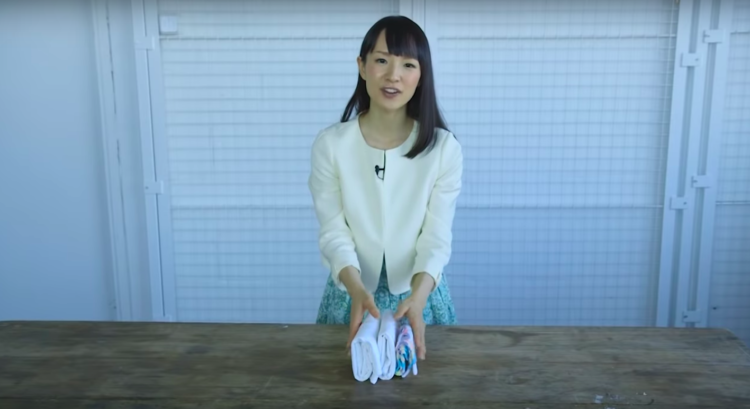 Image of Marie Kondo folding clothes