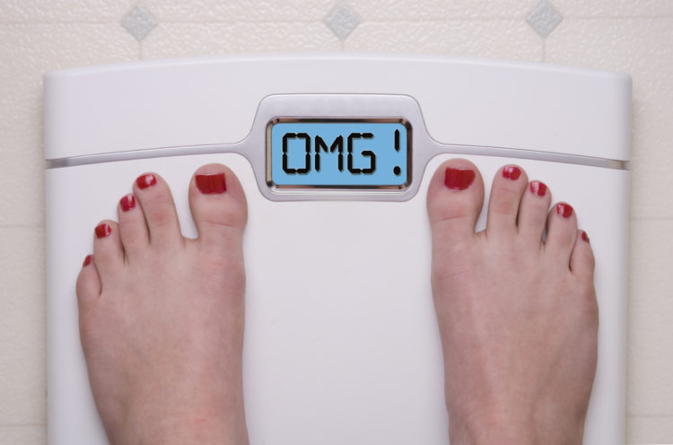 Image of digital bathroom scale displaying OMG message